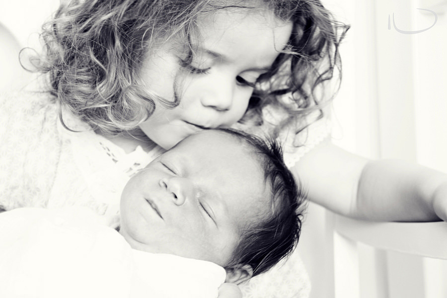 Randwick Sydney Family Photographer: Big sister kissing baby brother