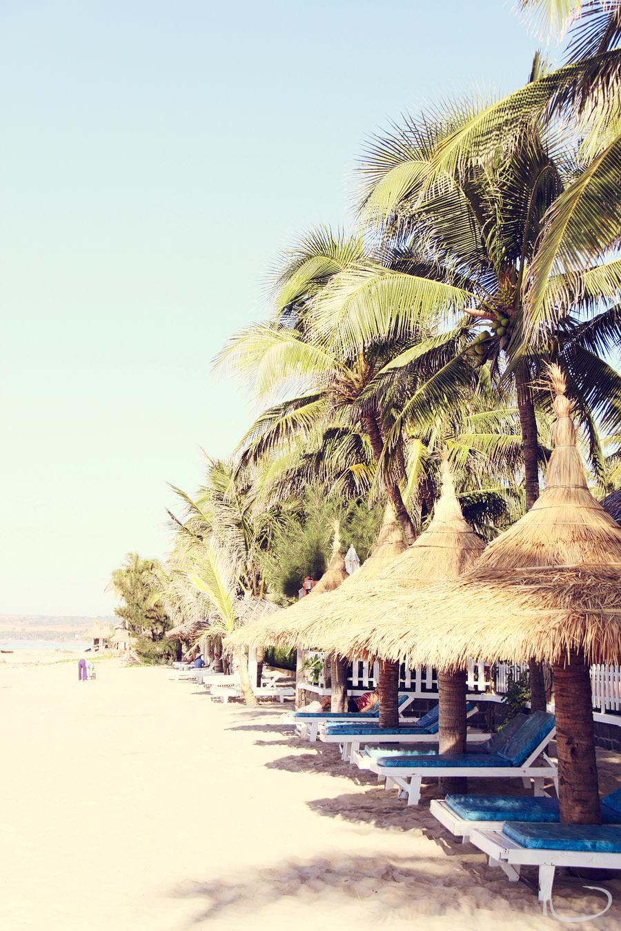 Vietnam Wedding Photographer: Straw umbrellas on beach