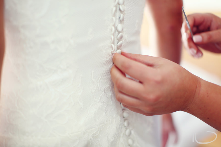 Apollo Bay Victoria Wedding Photographer: Bridesmaid dressing bride