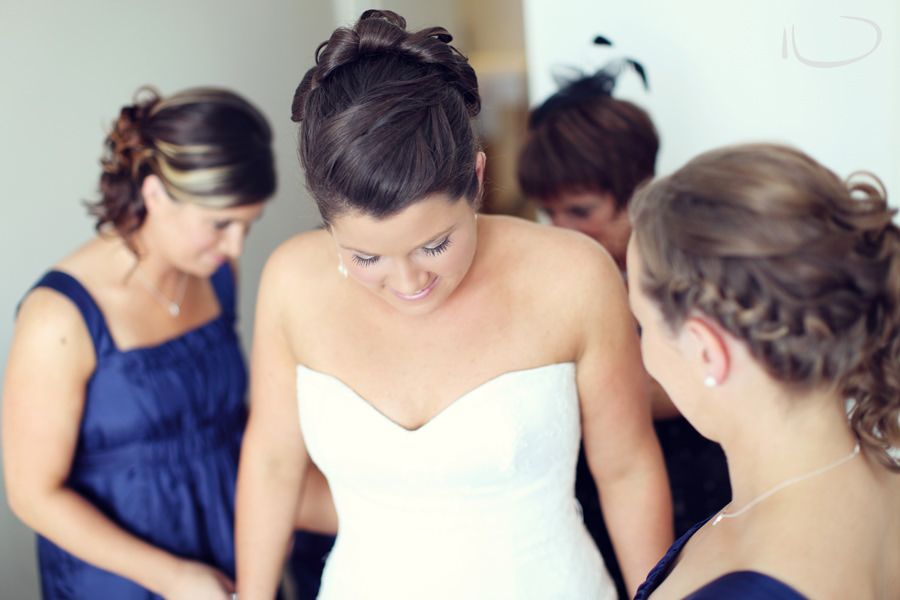 Apollo Bay Victoria Wedding Photographer: Bridesmaids helping bride get ready