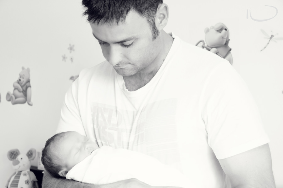 Brisbane Newborn Photographer: Father holding baby