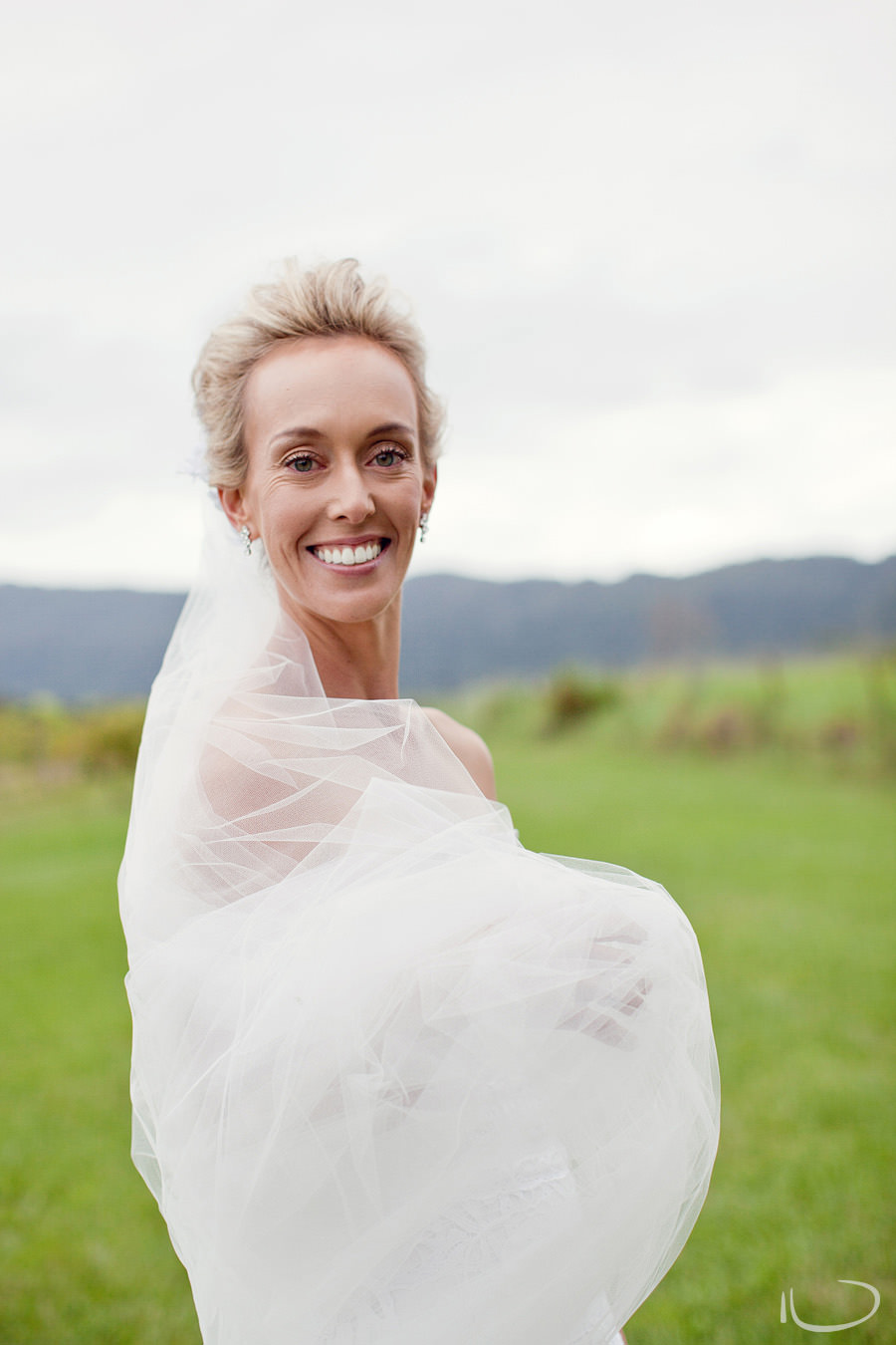 Silos Estate Berry Wedding Photographer: Bride wrapped in veil portrait