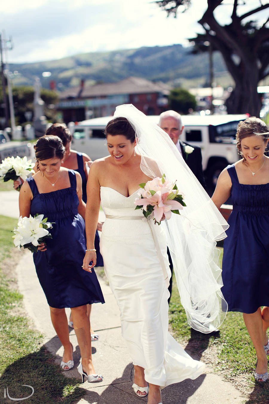 St. Aidans Church Apollo Bay Victoria Wedding Photographer: Bride walking into church with bridesmaids