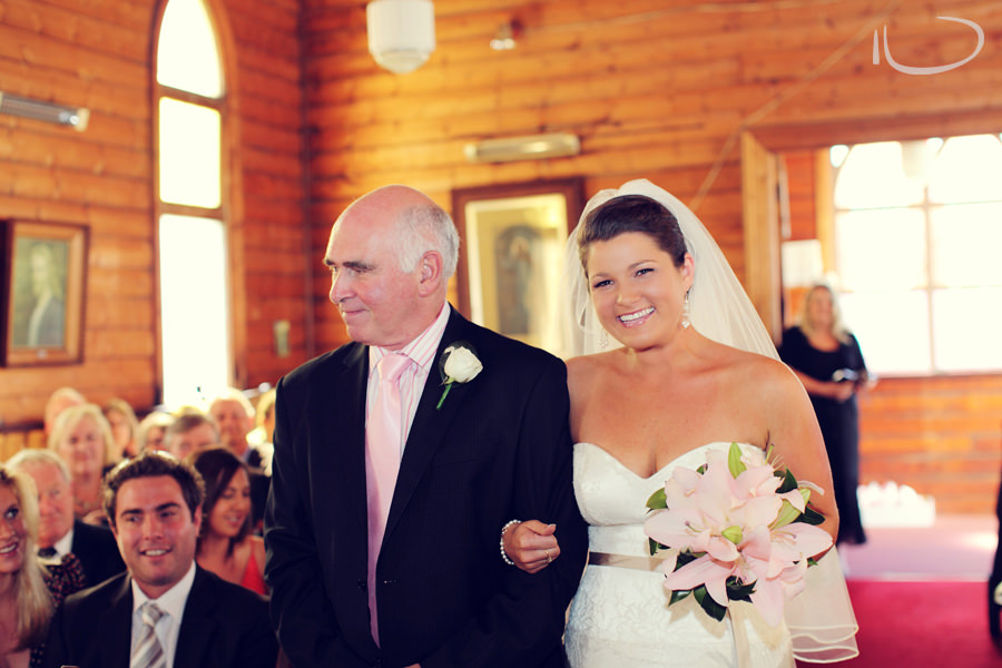 St. Aidans Church Apollo Bay Victoria Wedding Photographer: Bride & father walking down the aisle