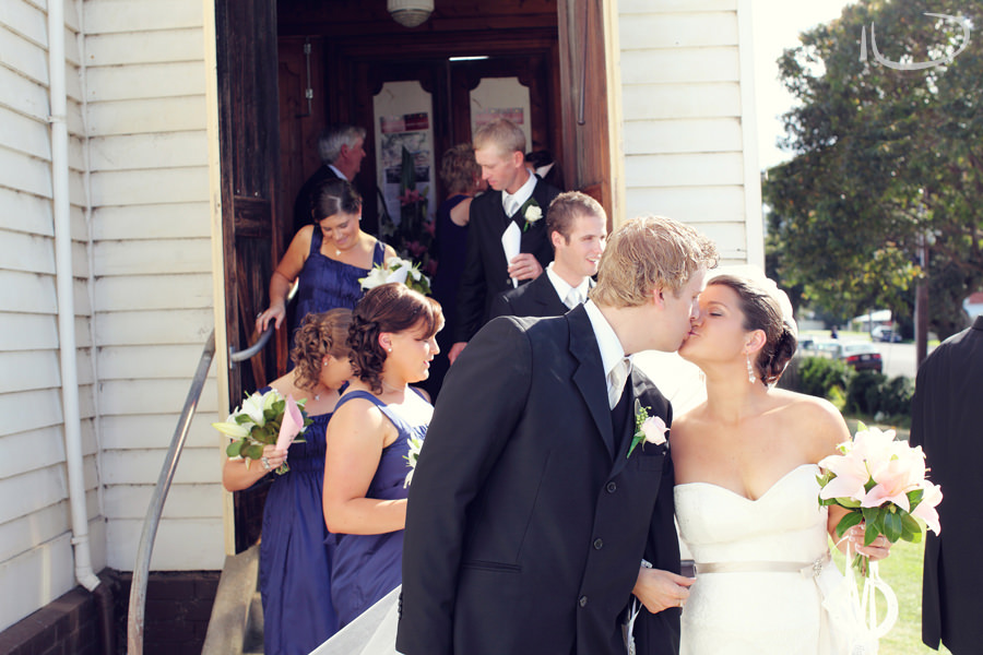 St. Aidans Church Apollo Bay Victoria Wedding Photographer: Bride & Groom kiss as exiting church