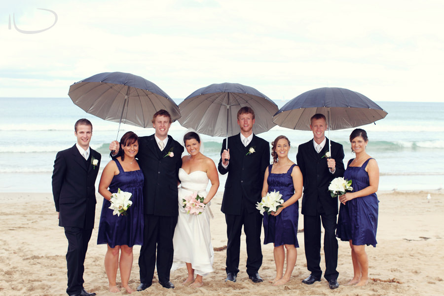 Otway Estate Barongarook Victoria Wedding Photographer: Bridal party on beach under umbrellas
