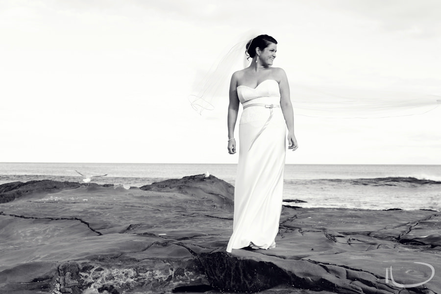 Otway Estate Barongarook Victoria Wedding Photographer: Bride on rocks with veil flowing in the wind