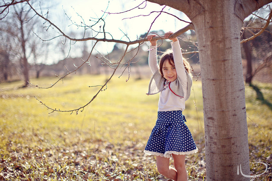 Canberra Family Photographer: Girl playing in trees