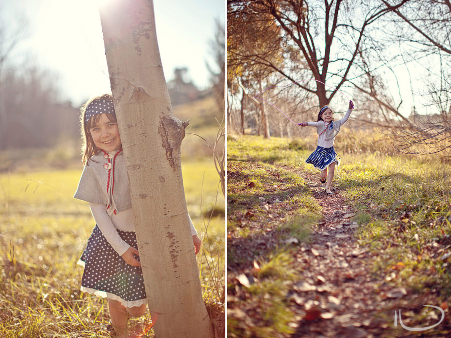Canberra Family Photographer: Girl skipping & hiding behind tree