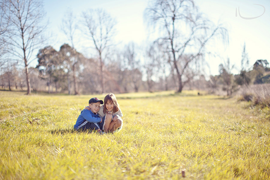 Canberra Family Photographer: Brother & sister playing in the grass