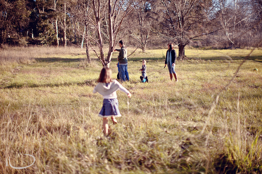 Canberra Family Photographer: Girl running towards family