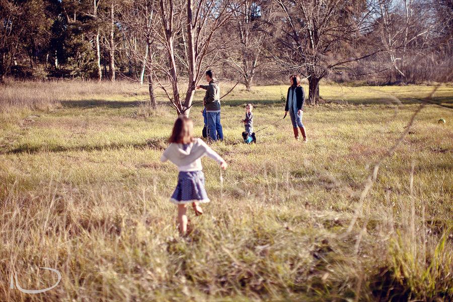 Canberra Family Photographer: Girl running towards family