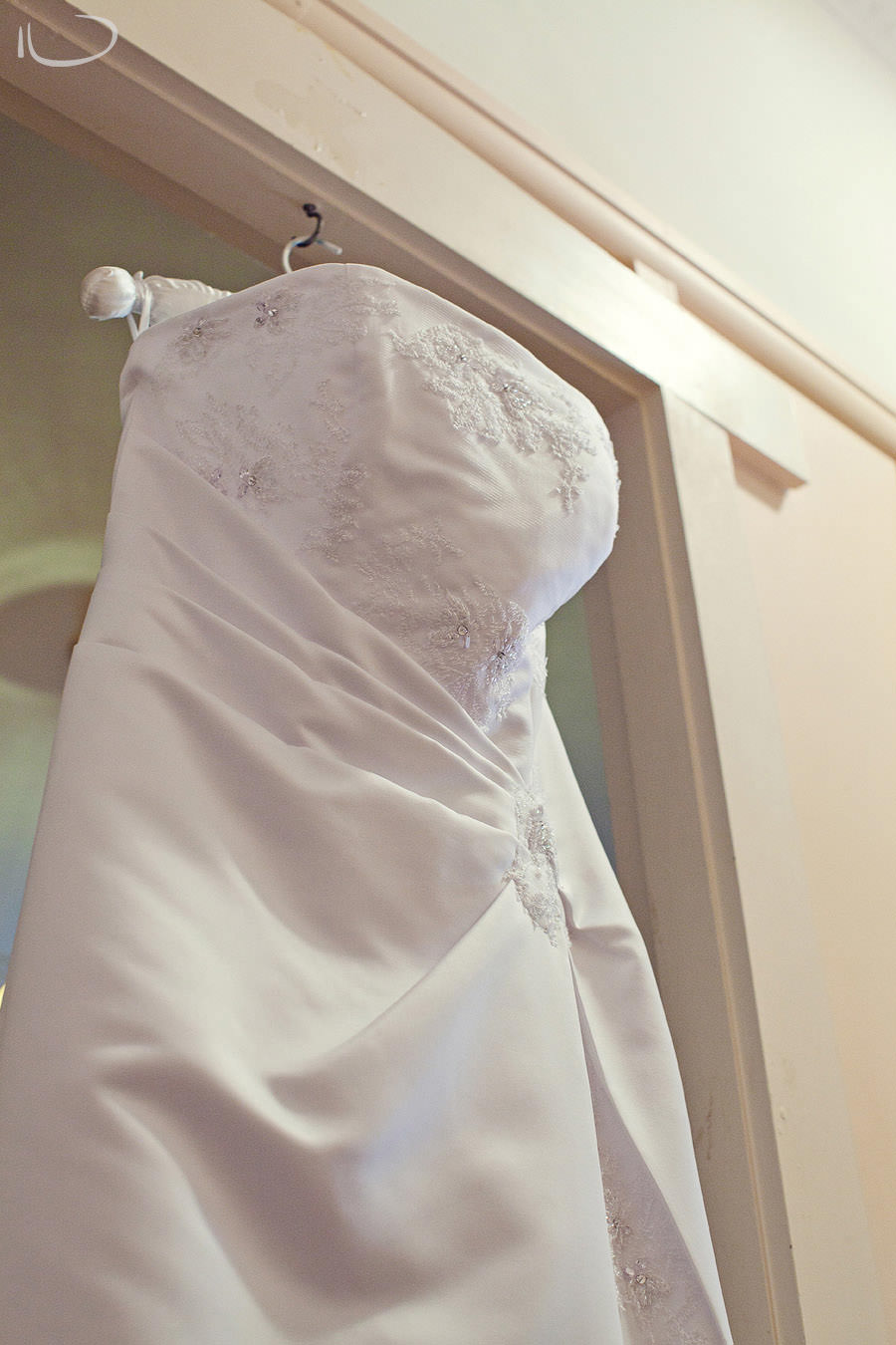 Strathfield Sydney Wedding Photographer: Bride dress handing from door