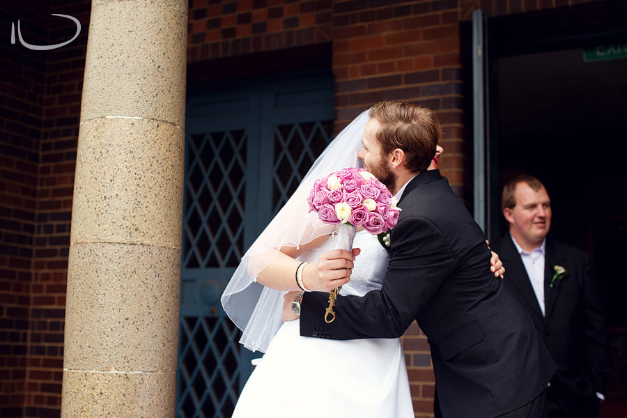 St Mary's Church Concord Sydney Wedding Photographer: Bride's brother congratulating her