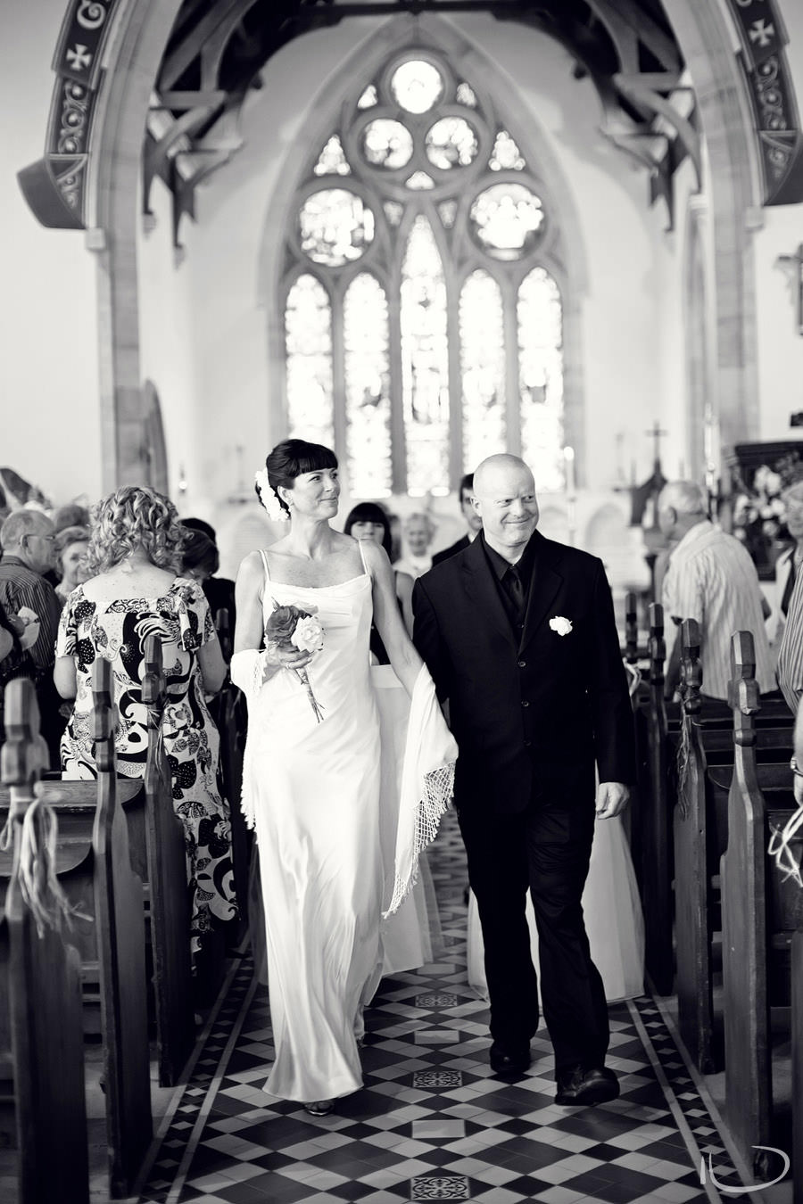 Sydney Wedding Photographer: Bride & Groom walking happily down the aisle