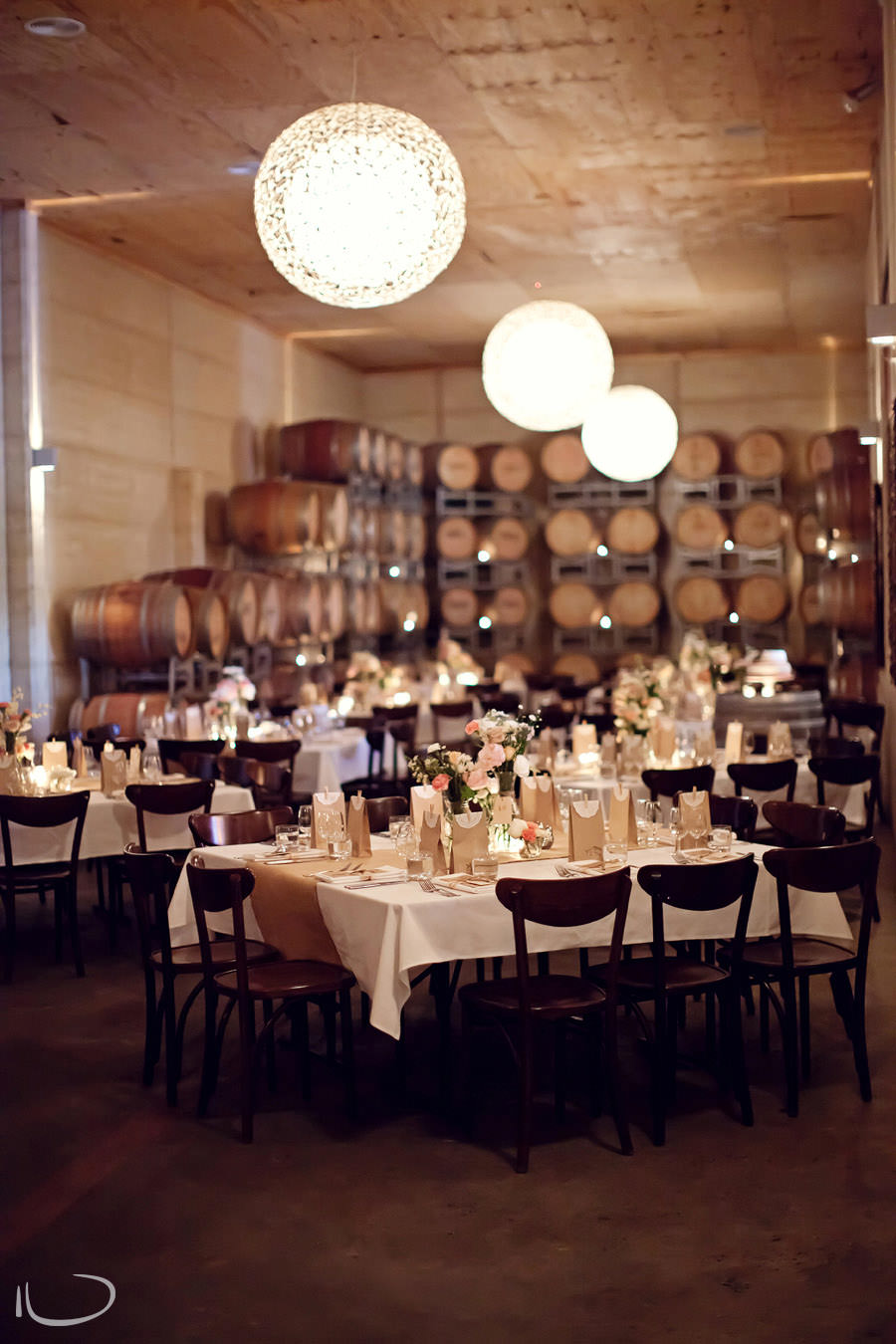Margan Winery Hunter Valley Wedding Photographer: Wedding reception wine barrel room setup