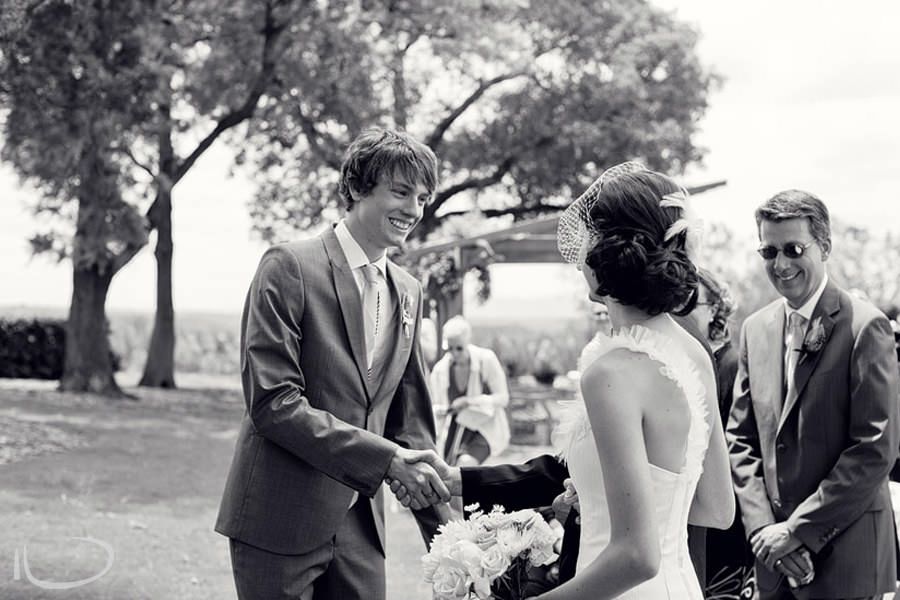 The Vintage Hunter Valley Wedding Photographer: Bride's father greeting groom and giving away bride