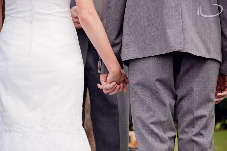 The Vintage Hunter Valley Wedding Photographer: Bride & Groom holding hands during ceremony