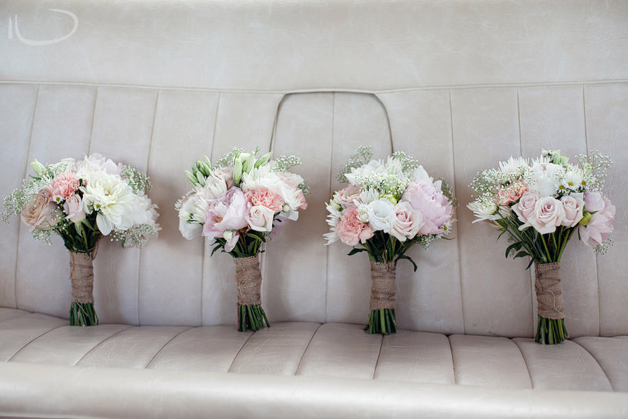 The Vintage Hunter Valley Wedding Photographer: Bridesmaid bouquets on back seat of wedding car