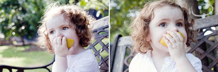 Kurrajong Blue Mountains Sydney Child Photographer: Toddler eating an orange