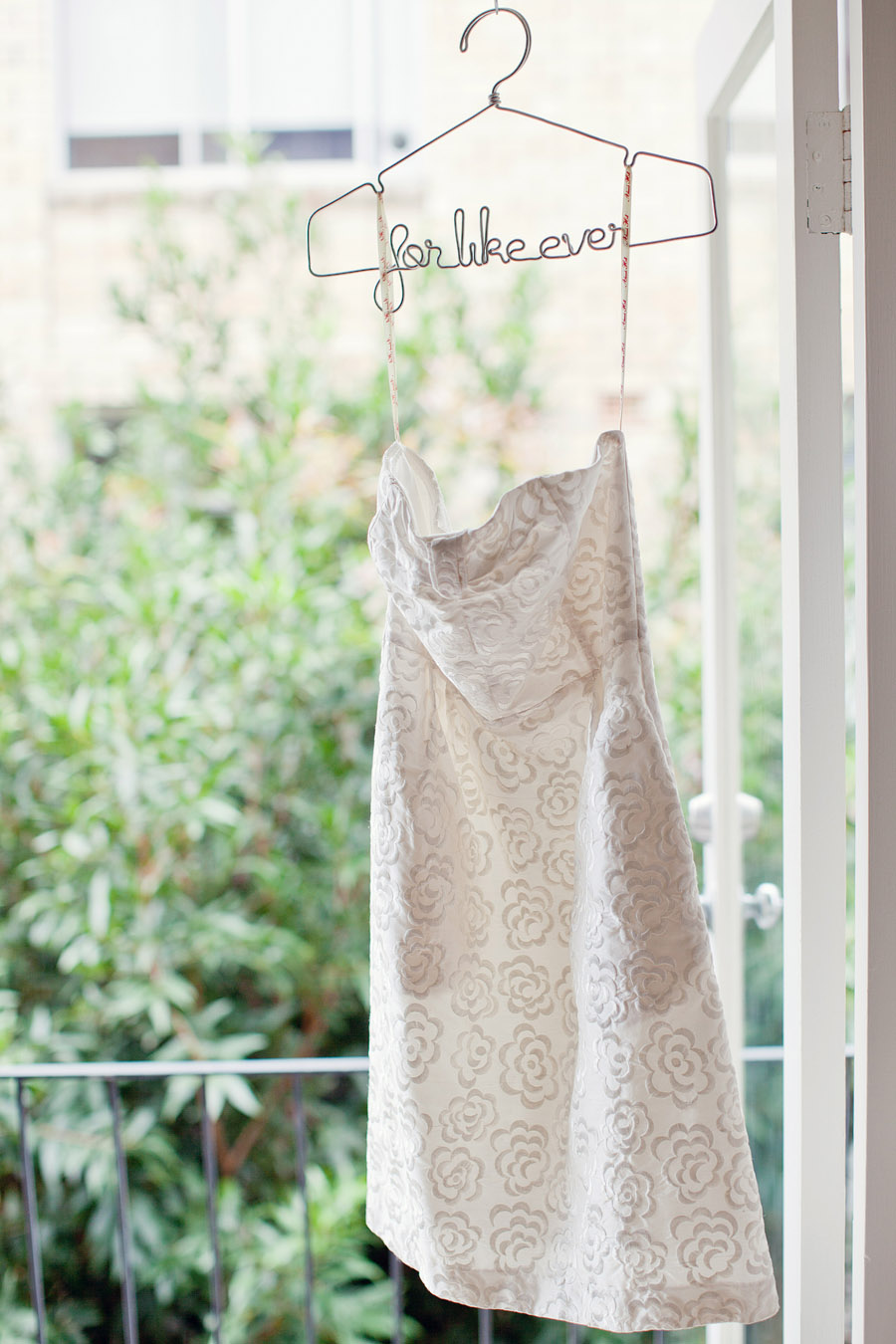 Sydney Wedding Photographer: Bride's dress hanging in door