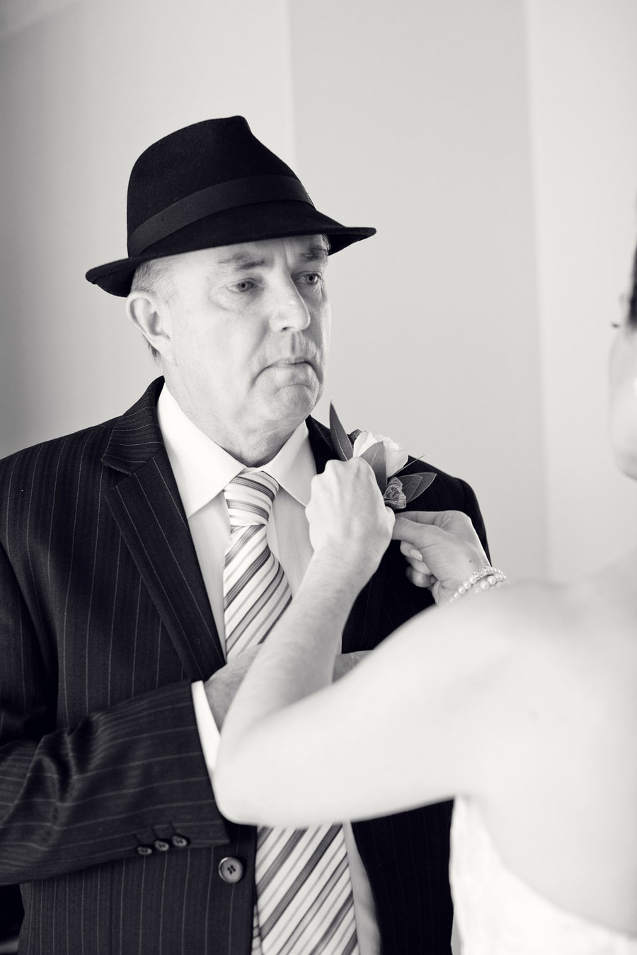 Sydney Wedding Photographer: Bride pinning boutonniere on father