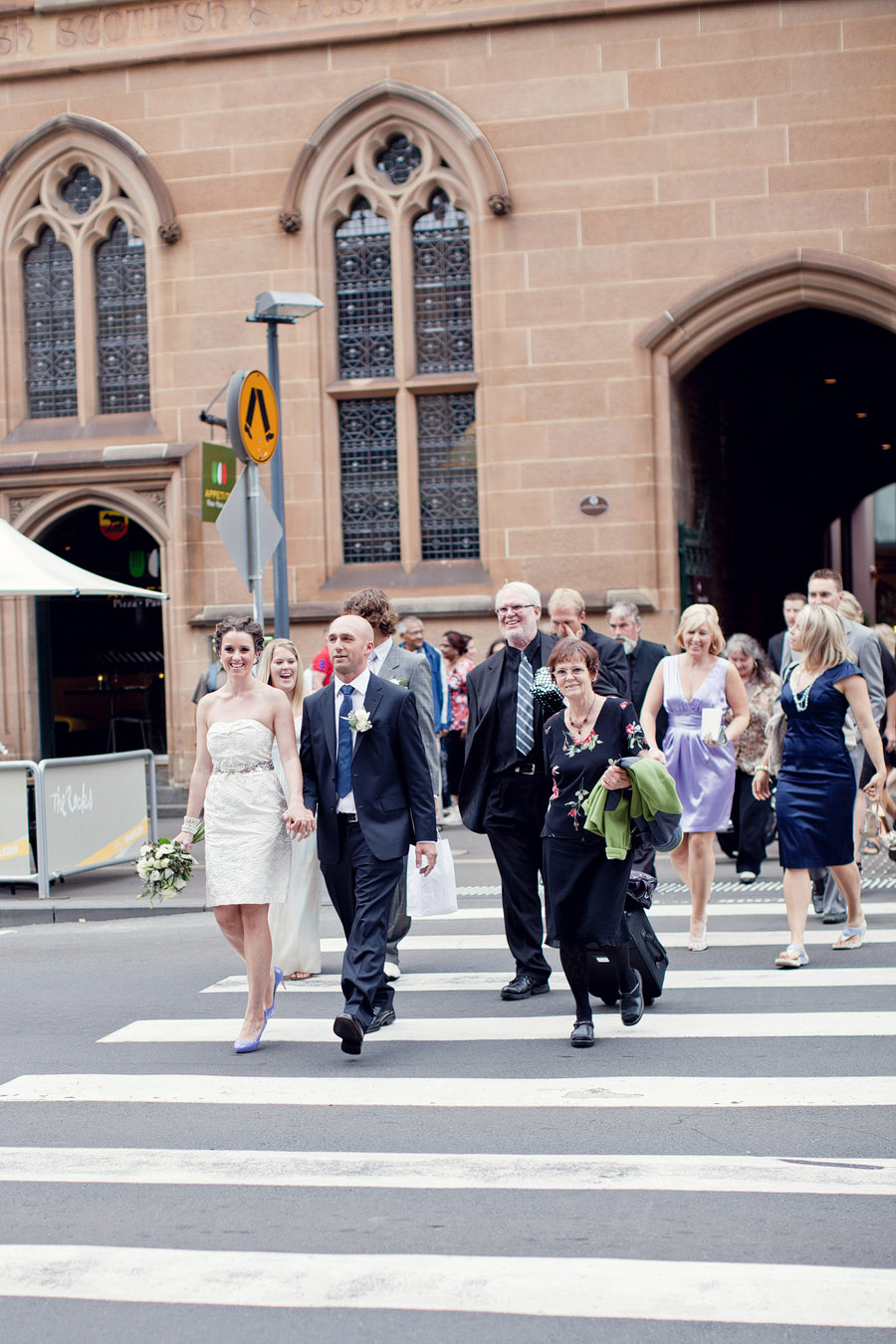 Sydney Wedding Photographer: Wedding party walking through the streets