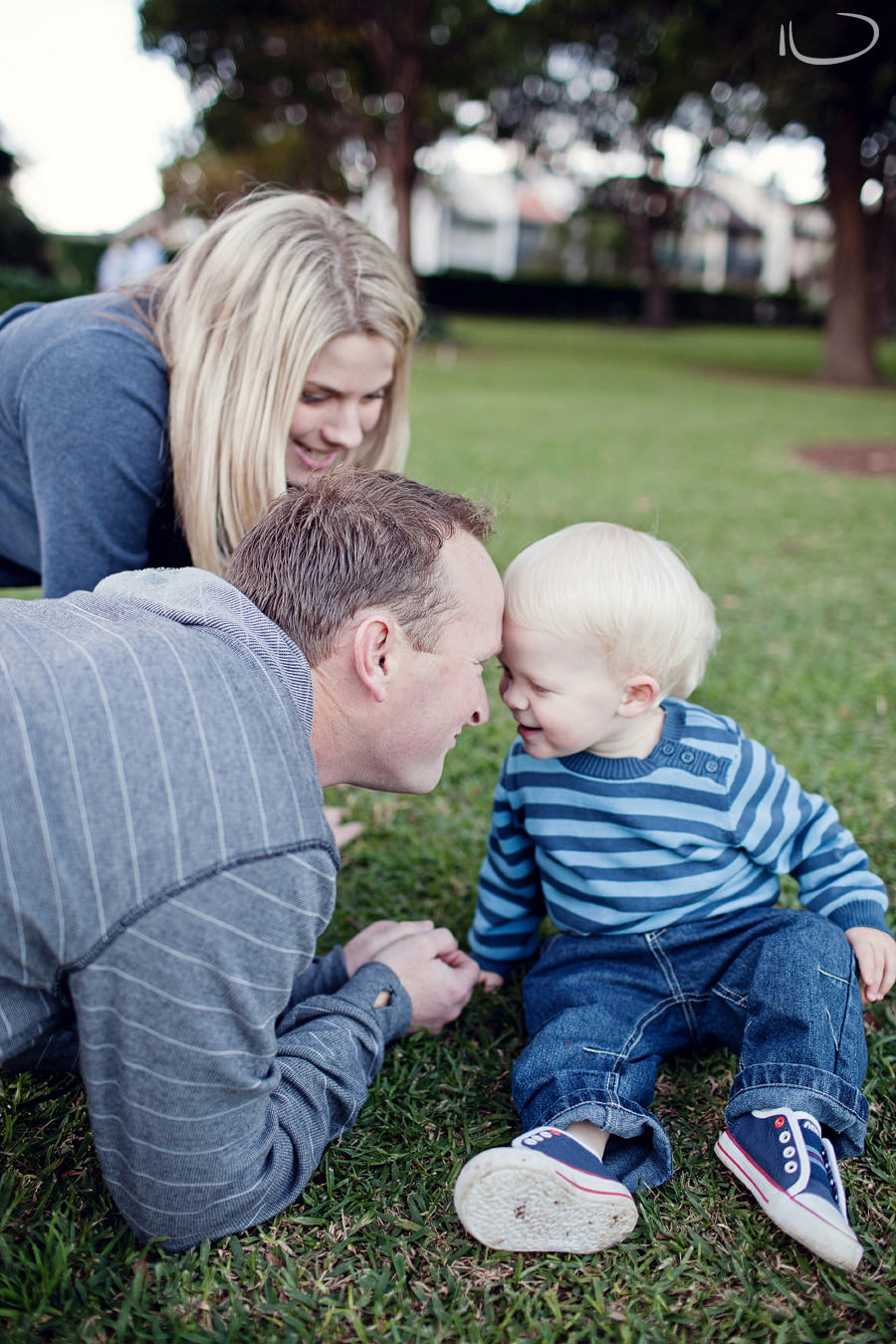 North Shore Family Photographer: Parents playing with son