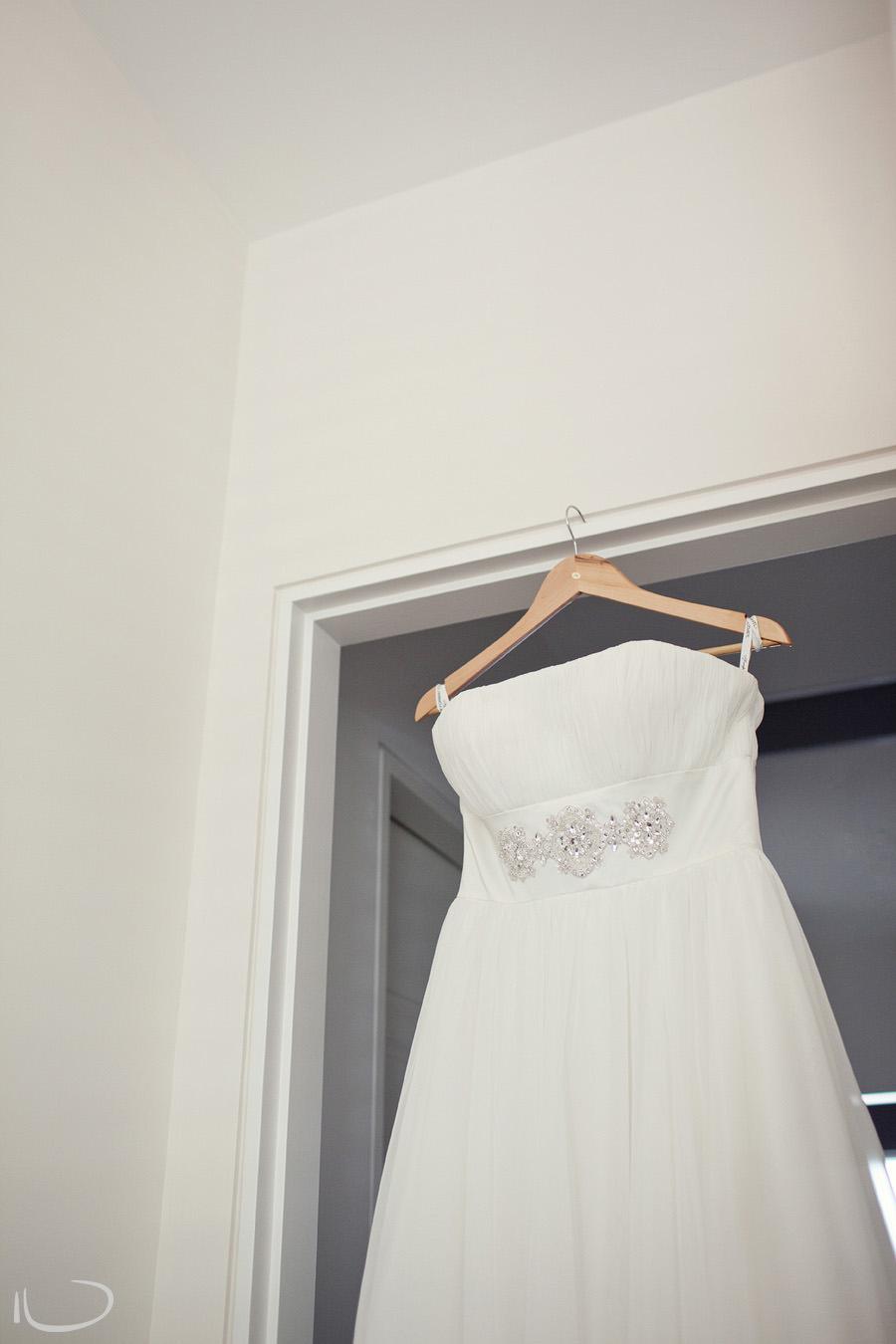 Cronulla Wedding Photographer: Wedding dress hanging from doorway