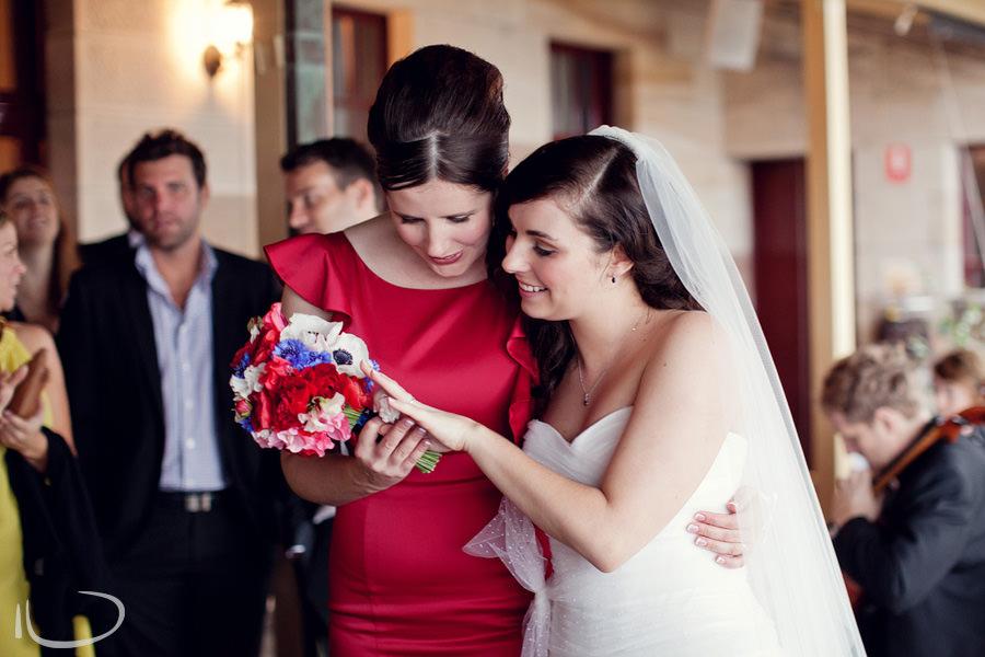 Gunners Barracks Wedding Photographer: Bride showing ring to bridesmaid