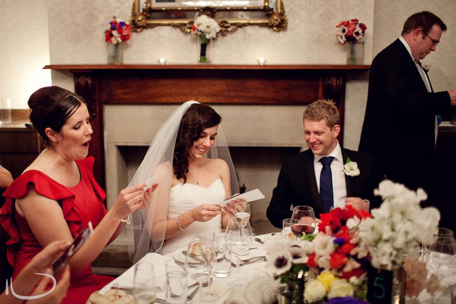 Gunners Barracks Wedding Photographer: Bride & groom during best man speech