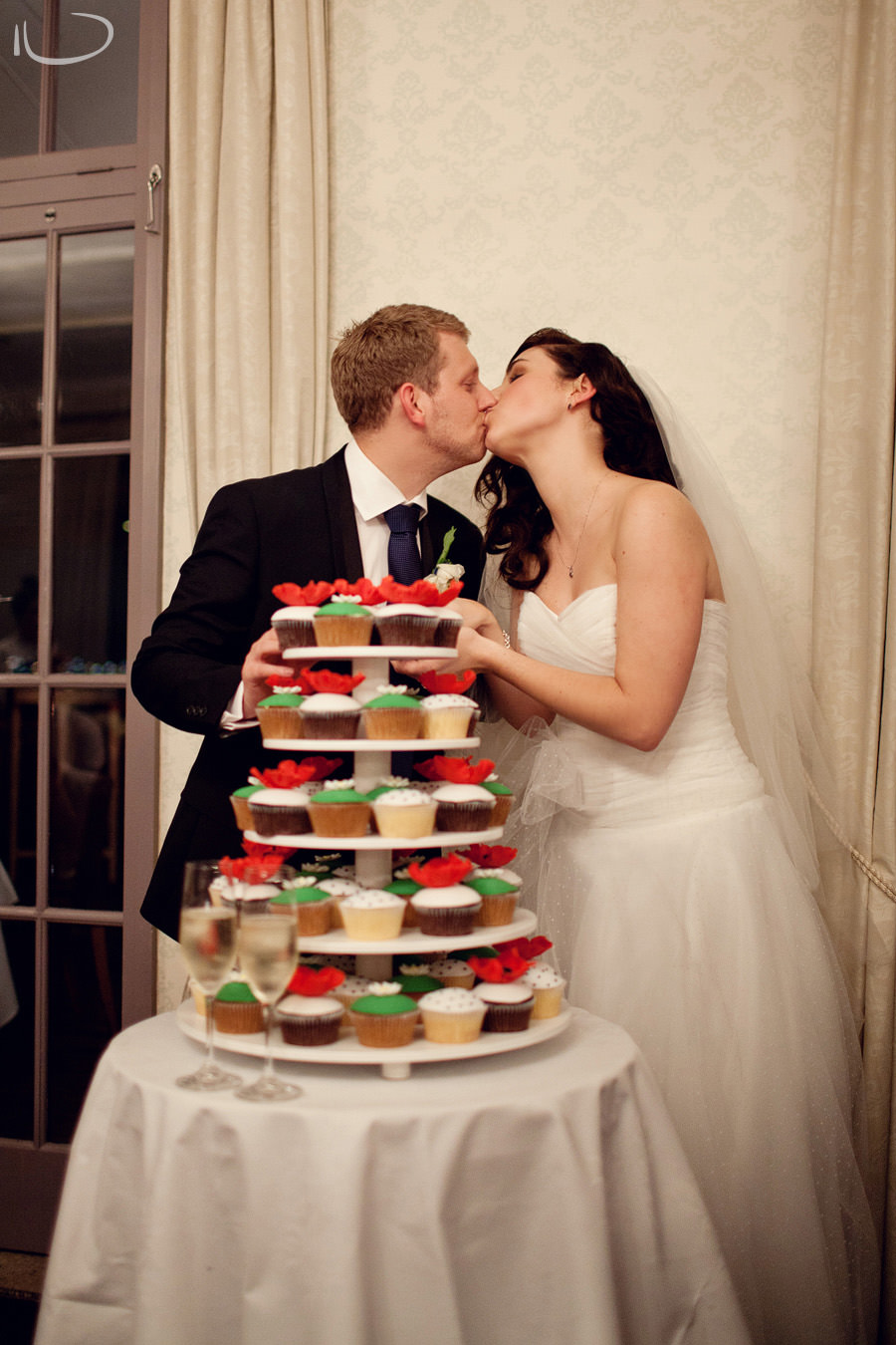 Gunners Barracks Wedding Photographer: Bride & groom kiss after cake cutting