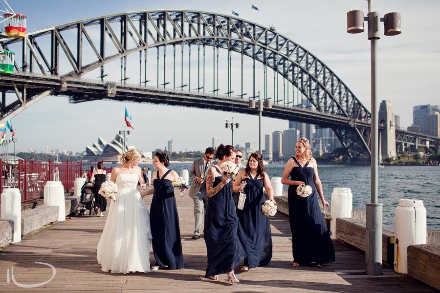 Luna Park Wedding Photographer: Bridal party walking along deck