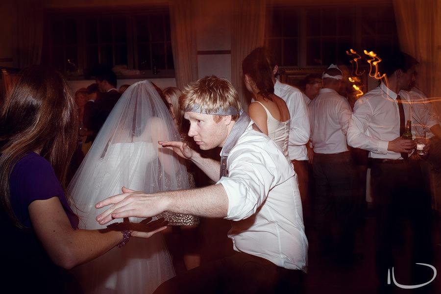 Mosman Wedding Photographer: Groomsman doing karate on dancefloor