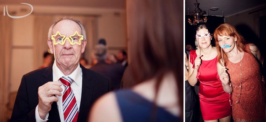 Mosman Wedding Photographer: Guests wearing photobooth props