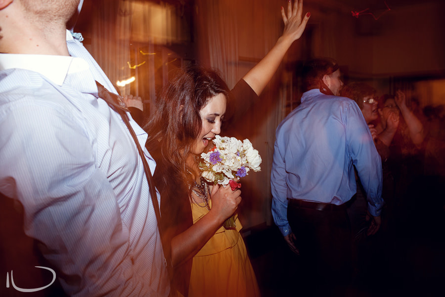Mosman Wedding Photographer: Girl singing into bouquet