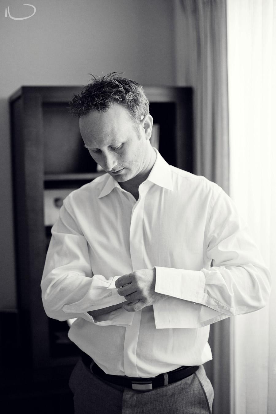 Sutherland Shire Wedding Photographer: Groom putting on cufflinks