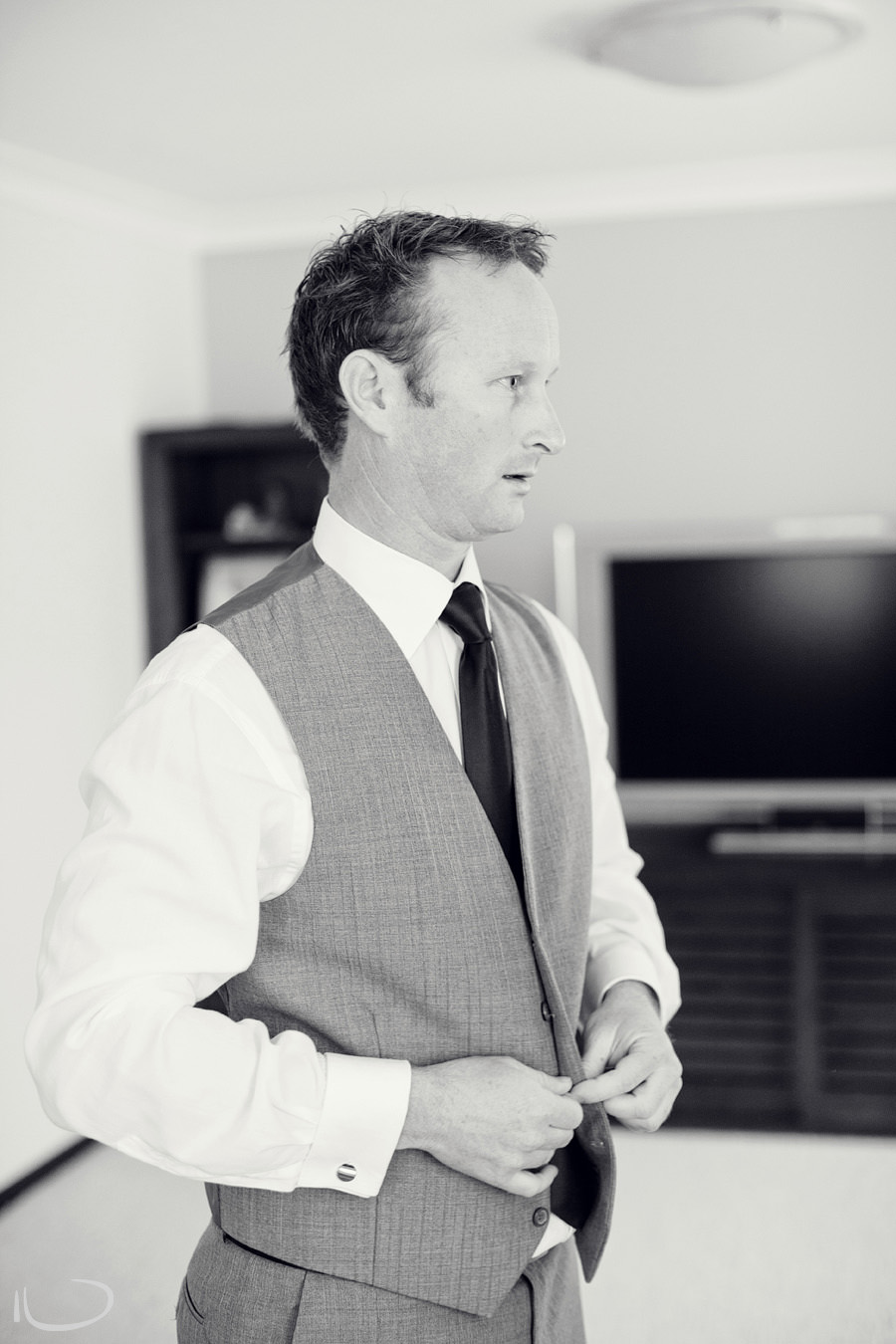 Sutherland Shire Wedding Photographer: Groom putting on vest