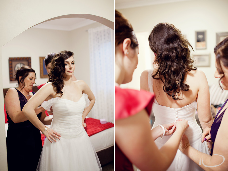 Sydney Wedding Photographer: Buttoning up bride's dress