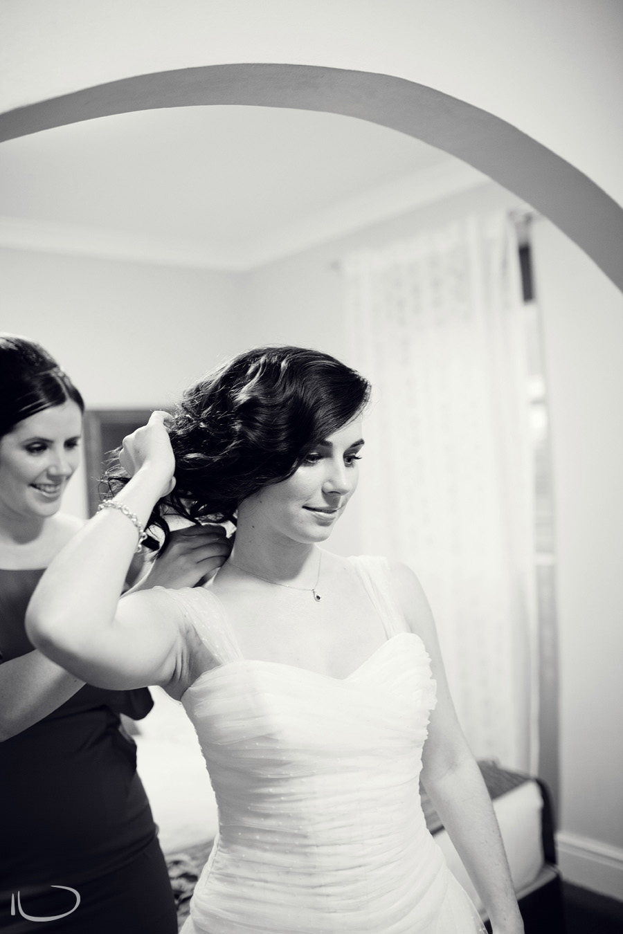Sydney Wedding Photographer: Bridesmaid putting necklace on bride