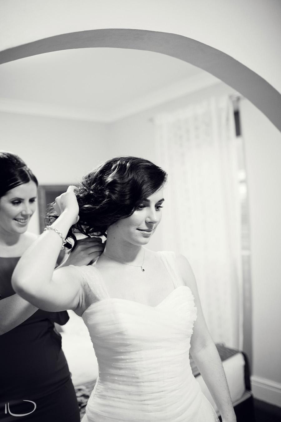 Sydney Wedding Photographer: Bridesmaid putting necklace on bride