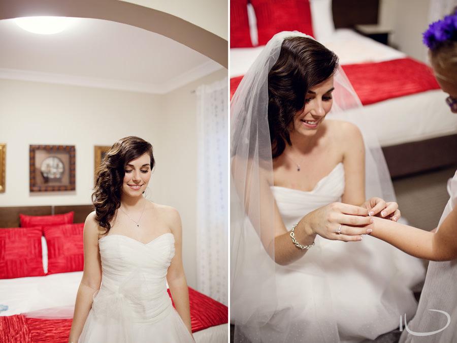 Sydney Wedding Photographer: Bride putting bracelet on flowergirl
