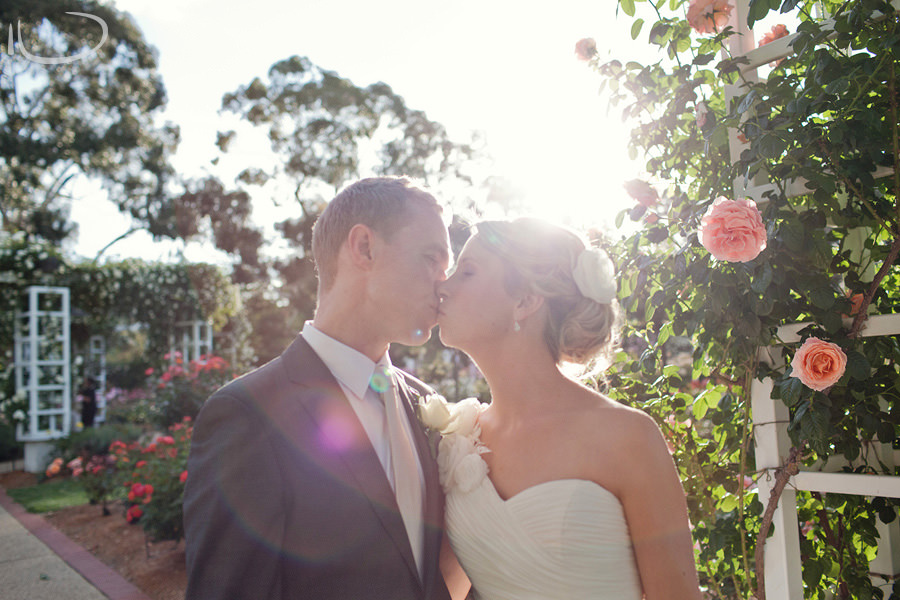 Canberra Wedding Photographer: Bride & groom kissing in garden