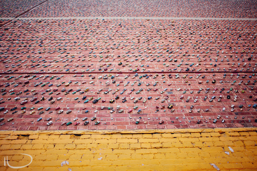 Adelaide Photographer: Toy cars stuck to wall