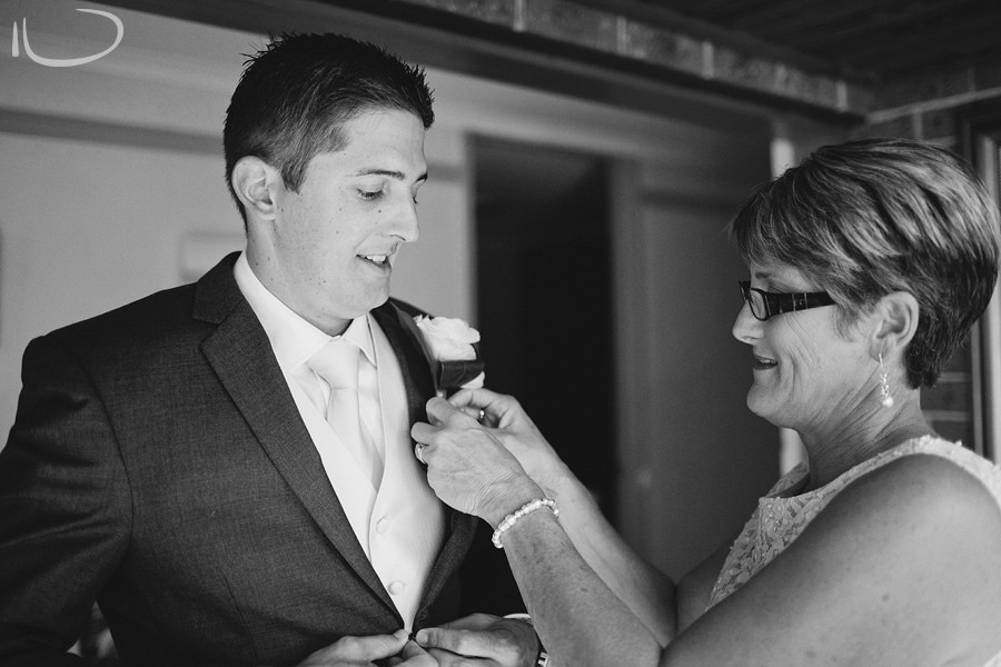 Canberra Wedding Photographers: Groom's mother pinning on boutonniere