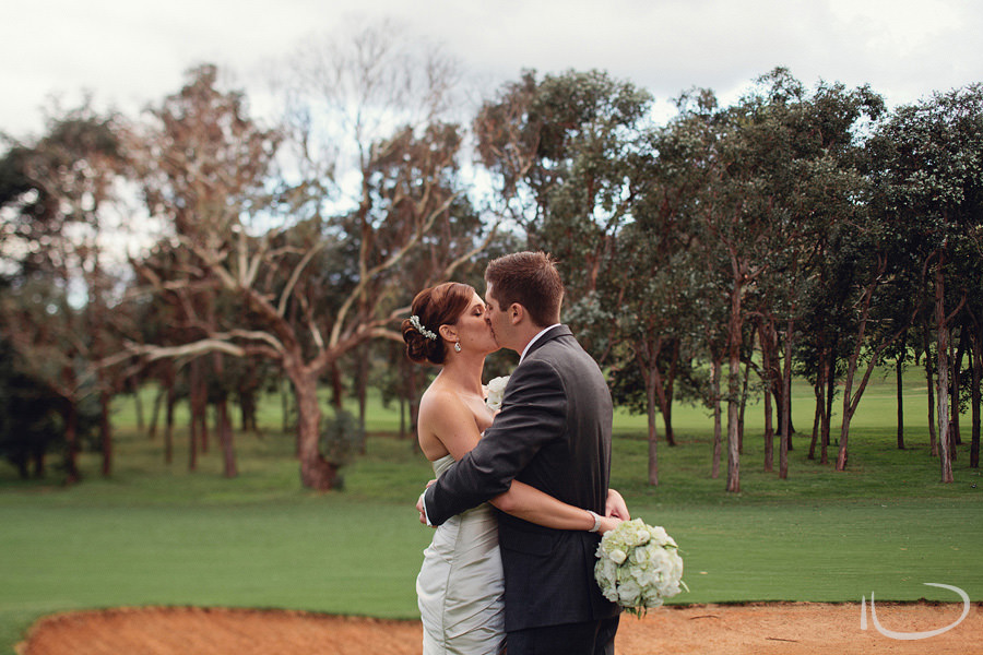 Federal Golf Club Wedding Photographers: Couple kissing on golf course