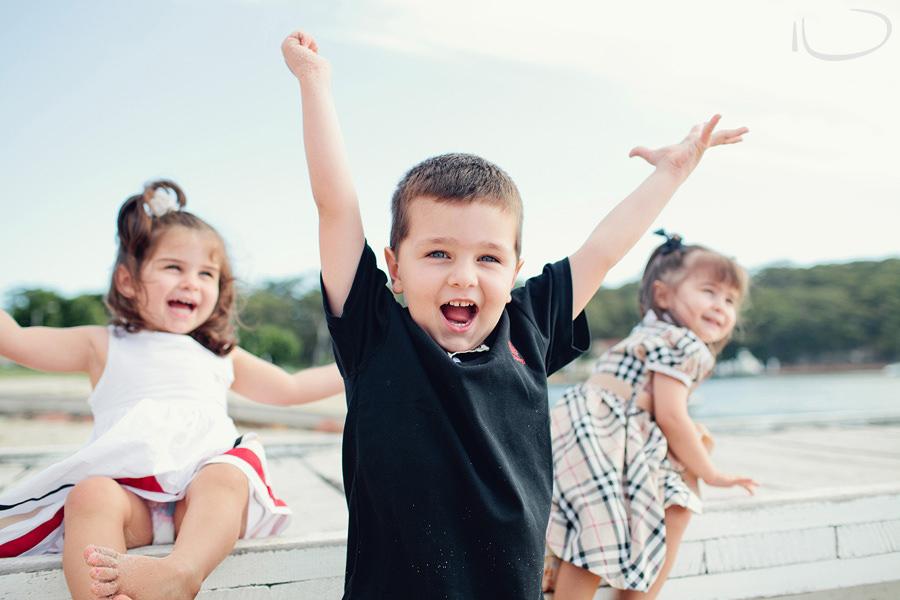 Nelson Bay Child Photographers: Boy star jumping of jetty