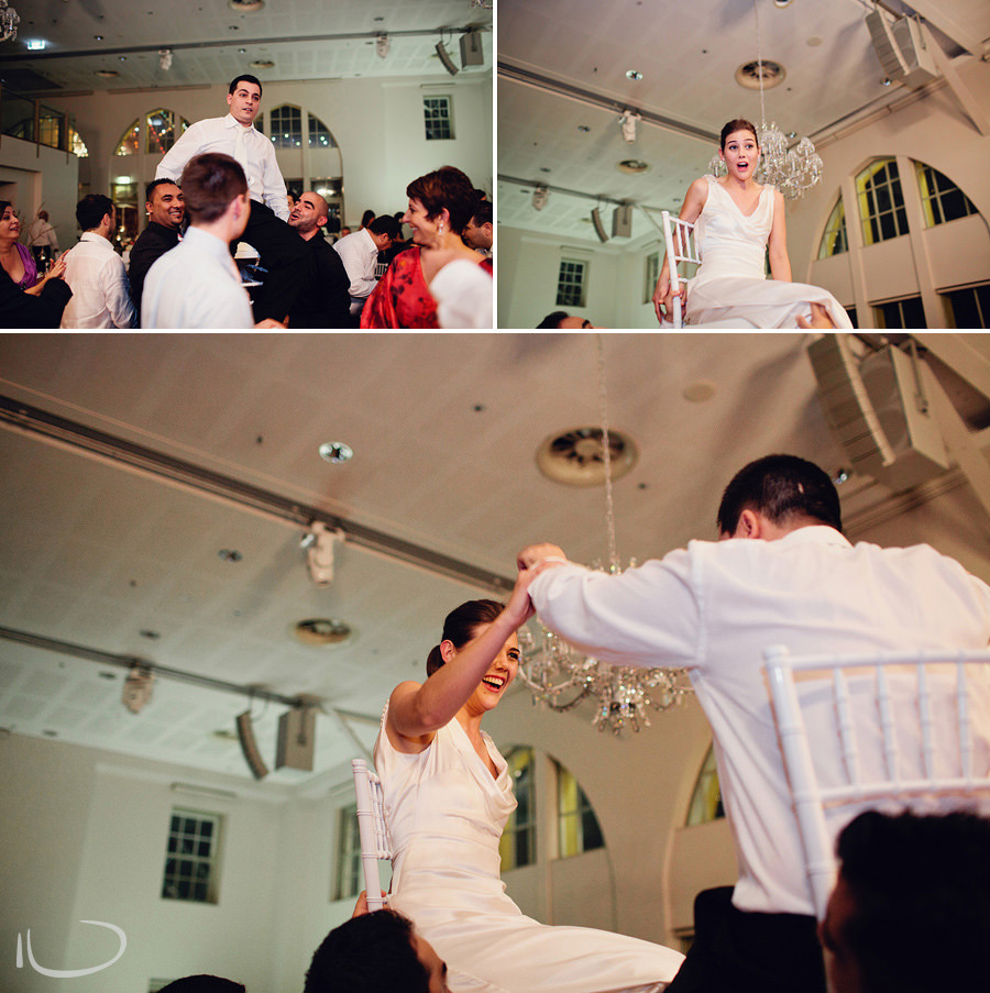 Armenian Wedding Photographers: Bride & groom hoisted up on chairs