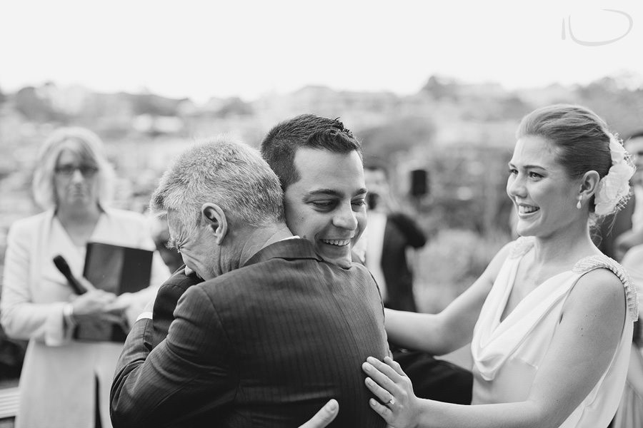 Lavender Bay Wedding Photography: Father of bride hugging groom