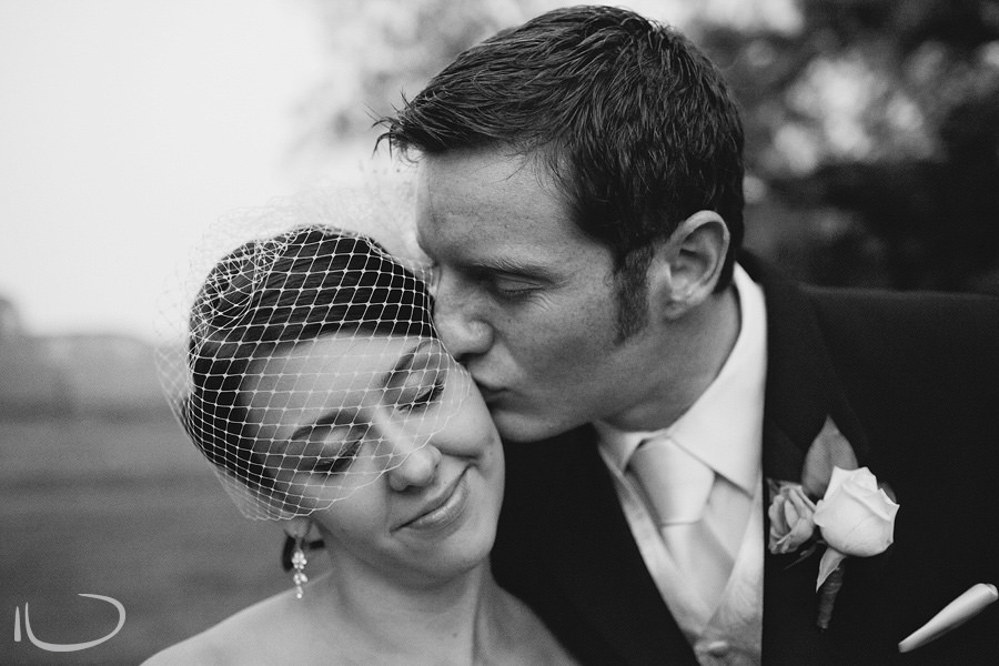 Sydney Wedding Photographer: Groom kissing bride on cheek